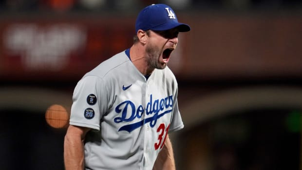 Oct 14, 2021; San Francisco, California, USA; Los Angeles Dodgers starting pitcher Max Scherzer (31) reacts after defeating the San Francisco Giants in game five of the 2021 NLDS at Oracle Park.