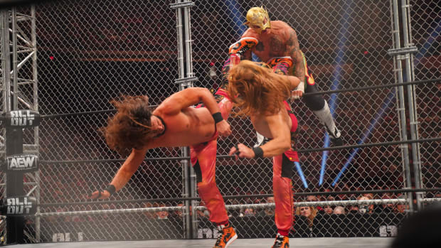 The Young Bucks (Matt and Nick Jackson) deliver a tandem superkick to Fenix at All Out