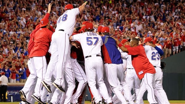 The Texas Rangers celebrate winning Game Six of the American League Championship Series 15-5 against the Detroit Tigers to advance to the World Series at Rangers Ballpark in Arlington on October 15, 2011 in Arlington, Texas. (credit: Kevork Djansezian/Getty Images)