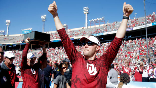 OU coach Lincoln Riley celebrates after the Red River Showdown, a 55-48 win against Texas, on Saturday at the Cotton Bowl in Dallas. Ou Vs Texas