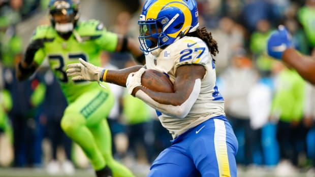 Oct 7, 2021; Seattle, Washington, USA; Los Angeles Rams running back Darrell Henderson (27) rushes against the Seattle Seahawks during the first quarter at Lumen Field. Mandatory Credit: Joe Nicholson-USA TODAY Sports