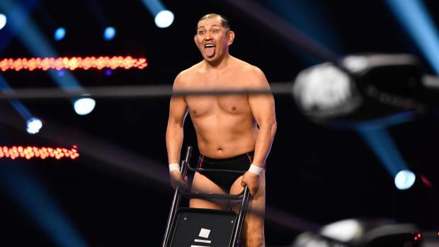 Minoru Suzuki holding a steel chair on AEW Dynamite