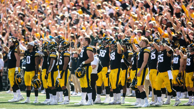 Iowa Hawkeyes players wave to patients in the Stead Family Children's Hospital during a NCAA non-conference football game against Colorado State, Saturday, Sept. 25, 2021, at Kinnick Stadium in Iowa City, Iowa.