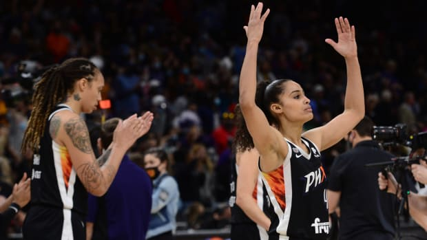 Phoenix Mercury center Brittney Griner and guard Skylar Diggins-Smith celebrate after beating the Chicago Sky in Game 2 of the 2021 WNBA Finals