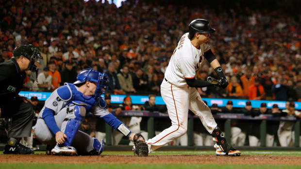 First base umpire Gabe Morales ruled Wilmer Flores swung for strike three to end the game and the Giants' season.