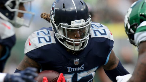 Derrick Henry, of the Tennessee Titans, runs against the New York Jets, Sunday, October 3, 2021.