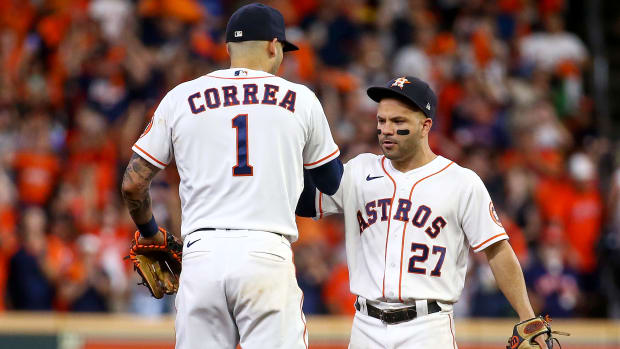 Oct 15, 2021; Houston, Texas, USA; Houston Astros second baseman Jose Altuve (27) and shortstop Carlos Correa (1) celebrate after the Astros defeated the Boston Red Sox in game one of the 2021 ALCS at Minute Maid Park.
