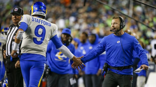 Oct 7, 2021; Seattle, Washington, USA; Los Angeles Rams head coach Sean McVay (right) celebrates with quarterback Matthew Stafford (9) following a touchdown against the Seattle Seahawks during the fourth quarter at Lumen Field.