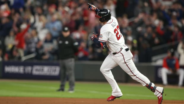 Oct 16, 2021; Cumberland, Georgia, USA; Atlanta Braves third baseman Austin Riley (27) hits a solo homer against the Los Angeles Dodgers during the fourth inning in game one of the 2021 NLCS at Truist Park.