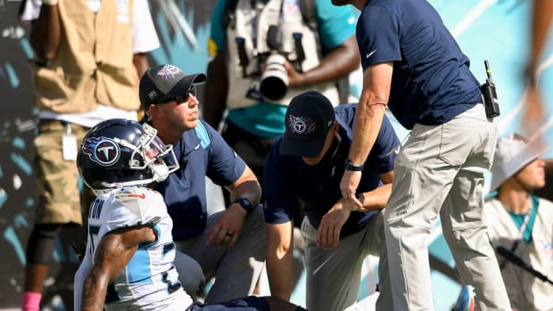 Tennessee Titans cornerback Kristian Fulton (26) is checked by trainers after getting hurt on a play at TIAA Bank Field Sunday, Oct. 10, 2021 in Jacksonville, Fla.