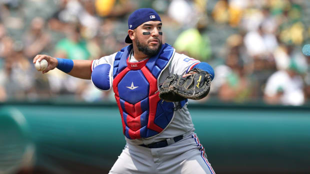 Aug 7, 2021; Oakland, California, USA; Texas Rangers catcher Jose Trevino (23) throws the ball to first base during the second inning against the Oakland Athletics at RingCentral Coliseum. Mandatory Credit: Darren Yamashita-USA TODAY Sports
