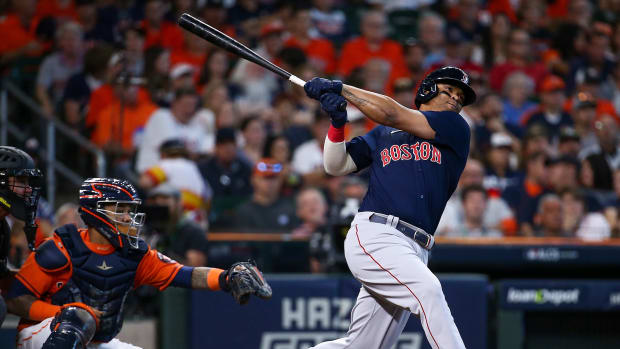 Oct 16, 2021; Houston, Texas, USA; Boston Red Sox third baseman Rafael Devers (11) hits a grand slam against the Houston Astros during the second inning in game two of the 2021 ALCS at Minute Maid Park.