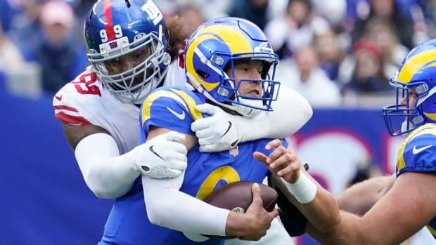 Oct 17, 2021; East Rutherford, New Jersey, USA; New York Giants defensive end Leonard Williams (99) wraps up Los Angeles Rams quarterback Matthew Stafford (9) for a sack in the 1st half at MetLife Stadium.