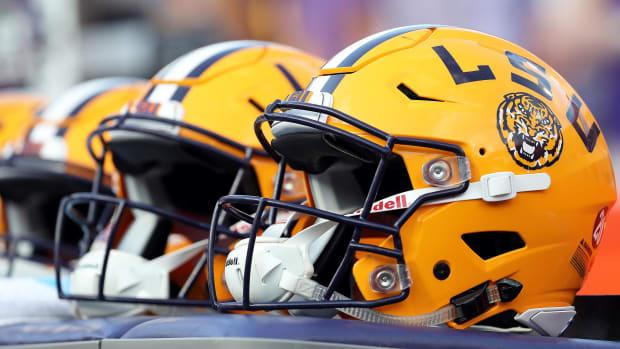 LSU football helmet sit on a bench