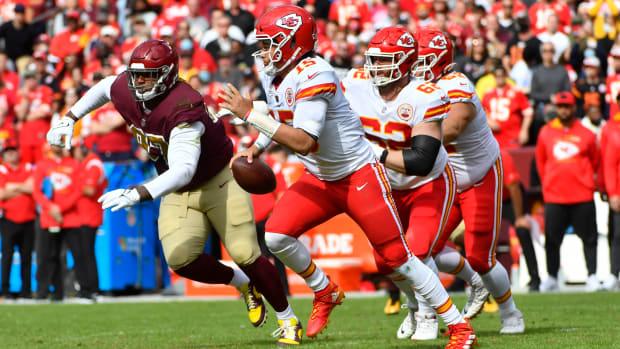Oct 17, 2021; Landover, Maryland, USA; Kansas City Chiefs quarterback Patrick Mahomes (15) scrambles against the Washington Football Team during the first half at FedExField. Mandatory Credit: Brad Mills-USA TODAY Sports