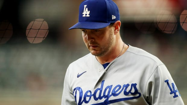 Oct 16, 2021; Cumberland, Georgia, USA; Los Angeles Dodgers starting pitcher Corey Knebel (46) walks to the dugout against the Atlanta Braves during the first inning in game one of the 2021 NLCS at Truist Park.