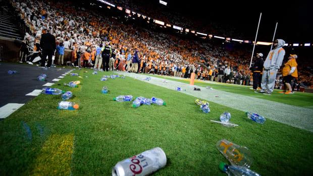 Fans throw trash on the field at Neyland Stadium.