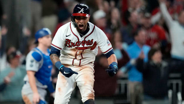Oct 17, 2021; Cumberland, Georgia, USA; Atlanta Braves left fielder Eddie Rosario (8) celebrates his walk off game winning RBI against the Los Angeles Dodgers  during the ninth inning in game two of the 2021 NLCS at Truist Park.