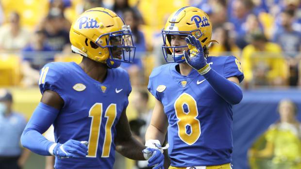 Pitt wide receiver Taysir Mack (11) and quarterback Kenny Pickett (8) talk