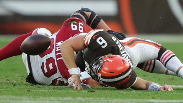 Cleveland Browns quarterback Baker Mayfield (6) lands awkwardly on his injured left shoulder as he is brought down by Arizona Cardinals defensive end J.J. Watt (99) during the second half of an NFL football game at FirstEnergy Stadium, Sunday, Oct. 17, 2021, in Cleveland, Ohio. [Jeff Lange/Beacon Journal] Browns 6