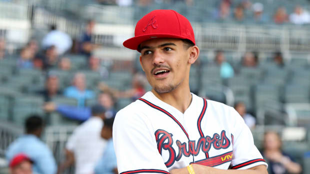Atlanta Hawks guard Trae Young (11) on the field before a game between the Atlanta Braves and Cincinnati Reds at SunTrust Park.