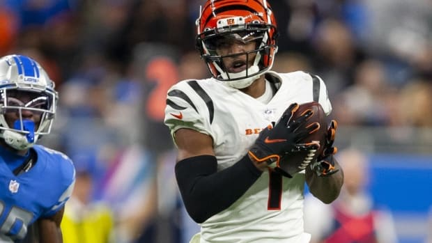 Oct 17, 2021; Detroit, Michigan, USA; Cincinnati Bengals wide receiver Ja'Marr Chase (1) makes a catch against Detroit Lions cornerback Jerry Jacobs (39) during the third quarter at Ford Field. Mandatory Credit: Raj Mehta-USA TODAY Sports