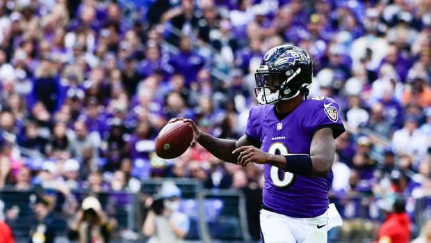 Lamar Jackson rolls out against the Chargers.
