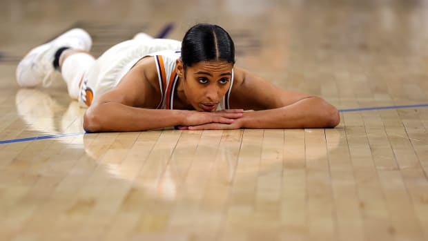 Skylar Diggins-Smith looking dejected laying on her stomach on the court