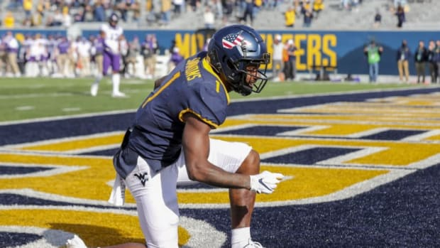 West Virginia football kneeling