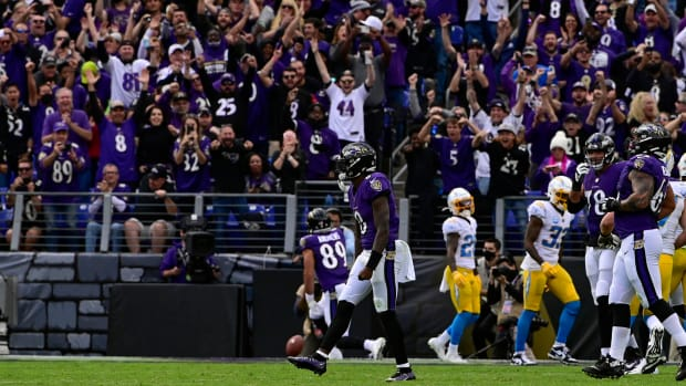 Lamar Jackson and Ravens fan celebrate a touchdown against the Chargers
