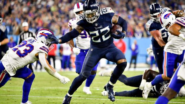 Tennessee Titans running back Derrick Henry (22) keeps Buffalo Bills safety Micah Hyde (23) at arms length as he runs for a touchdown at Nissan Stadium Monday, Oct. 18, 2021 in Nashville, Tenn.