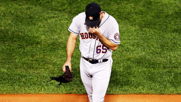 Oct 18, 2021; Boston, Massachusetts, USA; Houston Astros starting pitcher Jose Urquidy (65) walks off of the field after being taken out of the game during the second inning in game three of the 2021 ALCS against the Boston Red Sox at Fenway Park.