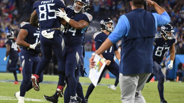 Tennessee Titans players celebrate after a defensive stop on fourth down late in the fourth quarter against the Buffalo Bills at Nissan Stadium.