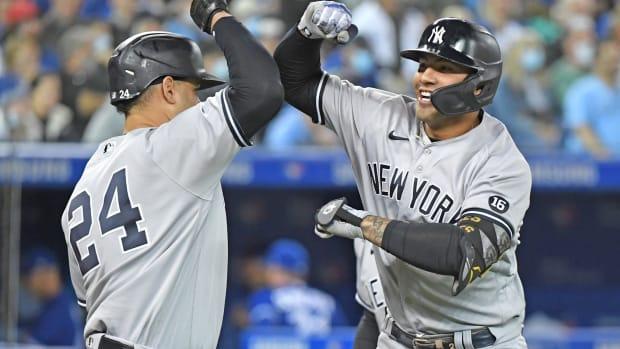 Yankees Gleyber Torres celebrates with Gary Sanchez