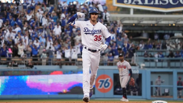 Oct 19, 2021; Los Angeles, California, USA; Los Angeles Dodgers first baseman Cody Bellinger (35) celebrates after hitting a three-run home run in the eighth inning of game three of the 2021 NLCS against the Atlanta Braves at Dodger Stadium.