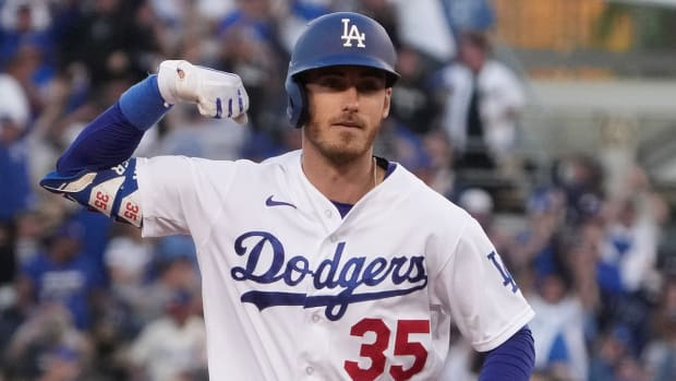 Los Angeles Dodgers first baseman Cody Bellinger (35) celebrates after hitting a three-run home run in the eighth inning of game three of the 2021 NLCS against the Atlanta Braves at Dodger Stadium.