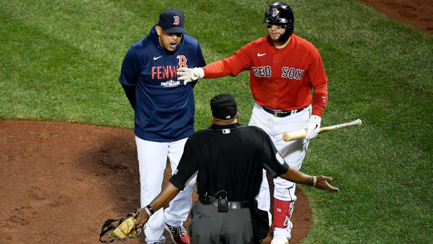 Oct 19, 2021; Boston, Massachusetts, USA; Boston Red Sox catcher Christian Vazquez (7) separates manger Alex Cora from home plate umpire Laz Diaz during the third inning of game four of the 2021 ALCS against the Houston Astros at Fenway Park.