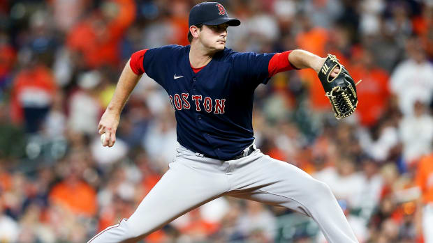 Oct 16, 2021; Houston, Texas, USA; Boston Red Sox relief pitcher Garrett Whitlock (72) pitches against the Houston Astros during the seventh inning in game two of the 2021 ALCS at Minute Maid Park.