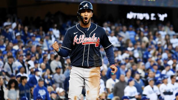 Oct 20, 2021; Los Angeles, California, USA; Atlanta Braves left fielder Eddie Rosario (8) celebrates scoring in the third inning a during game four of the 2021 NLCS at Dodger Stadium.
