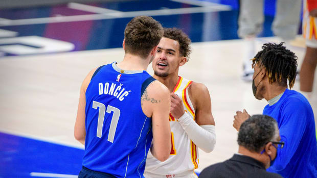 Dallas Mavericks guard Luka Doncic (77) talks with Atlanta Hawks guard Trae Young (11) after the game at the American Airlines Center.