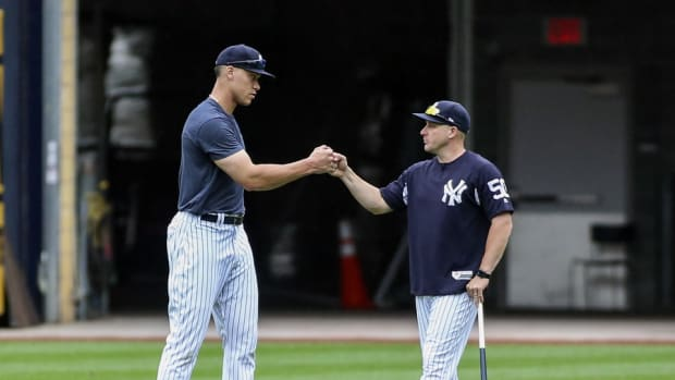 Yankees first base coach Reggie Willits with Aaron Judge