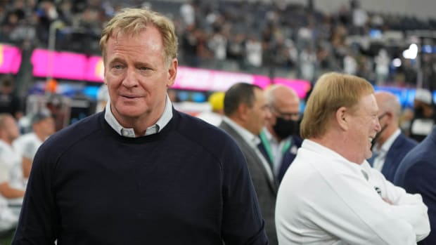 Oct 4, 2021; Inglewood, California, USA; NFL Commissioner Roger Goodell walks along the sidelines as Las Vegas Raiders owner Mark Davis (right) looks on before a game between the Los Angeles Chargers and the Raiders at SoFi Stadium.