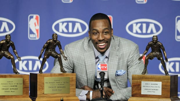 NBA All-Star Dwight Howard poses with his awards