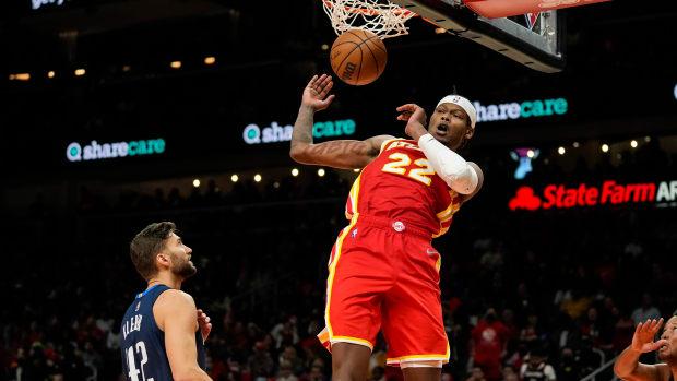 Atlanta Hawks forward Cam Reddish (22) dunks behind Dallas Mavericks forward Maxi Kleber (42) during the second half at State Farm Arena.