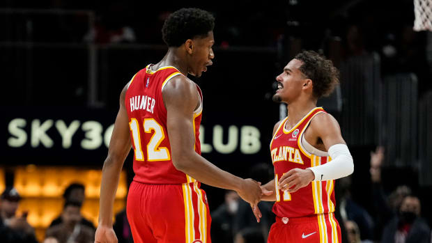 Atlanta Hawks forward De'Andre Hunter (12) shakes hands with guard Trae Young (11) after making a shot against the Dallas Mavericks during the second half at State Farm Arena.