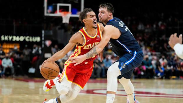 Atlanta Hawks guard Trae Young (11) dribbles against Dallas Mavericks guard Luka Doncic (77) during the second half at State Farm Arena.