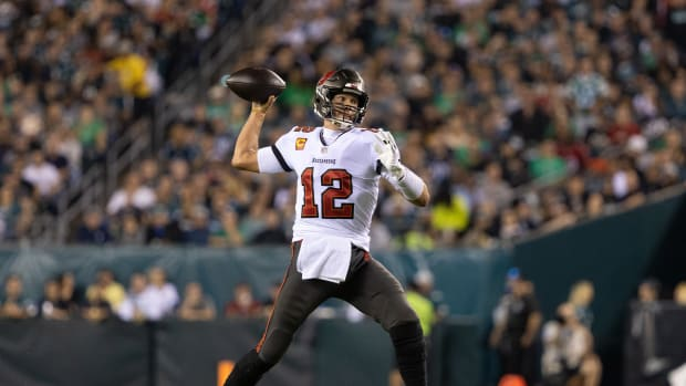 Oct 14, 2021; Philadelphia, Pennsylvania, USA; Tampa Bay Buccaneers quarterback Tom Brady (12) throws a touchdown pass to wide receiver Antonio Brown (not pictured) during the first quarter against the Philadelphia Eagles at Lincoln Financial Field.