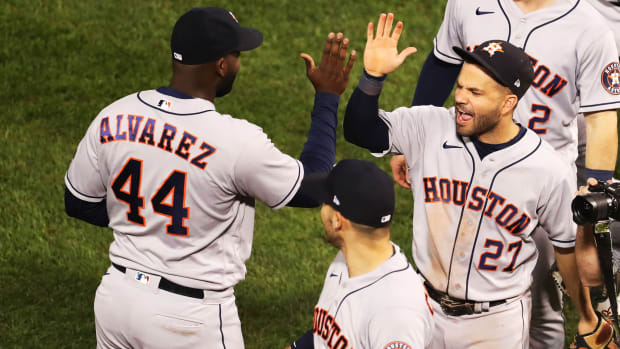 Oct 20, 2021; Boston, Massachusetts, USA; Houston Astros designated hitter Yordan Alvarez (44) and second baseman Jose Altuve (27) high-five after defeating the Boston Red Sox in game five of the 2021 ALCS at Fenway Park.