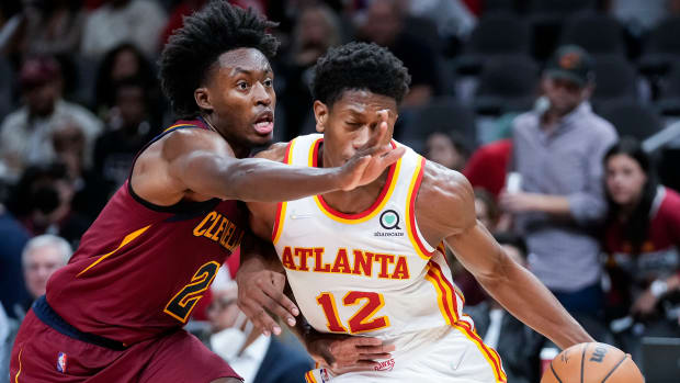 Atlanta Hawks forward De'Andre Hunter (12) is guarded by Cleveland Cavaliers guard Collin Sexton (2) during the second half at State Farm Arena.