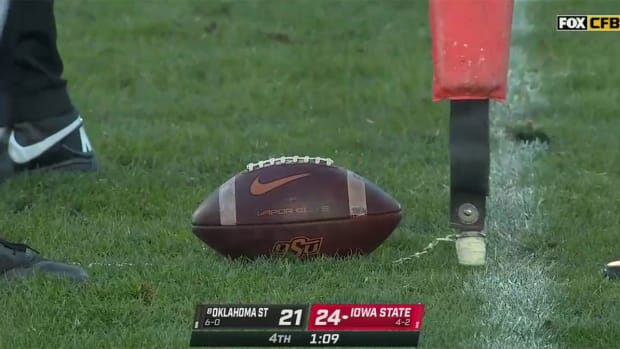 The ball just inches short of a first down during a game between Iowa State and Oklahoma State.